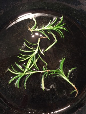 a few sprigs of rosemary cooking in the oil.