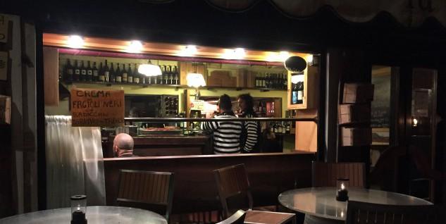 Gondoliers at the bar at La Cantina, enjoying the produce.
