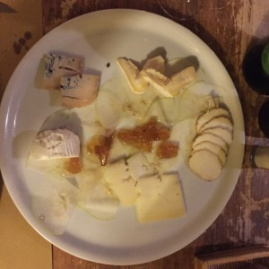 cheese selection, with transparent slices of apple as a base and a pineapple condiment.