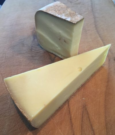 The Eigernordwandkase (front) and Gabietou cheeses, stars of the Tour de France selection.